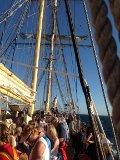 Business advisor Tony Inman helps raise a sail aboard the Leeuwin II