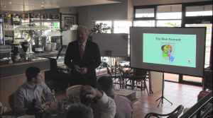 Tony Inman addresses a group of business owners at a networking breakfast