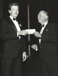 Coach Tony Inman receiving a business award at the London Hilton Hotel from the President of the Confederation of British Industry